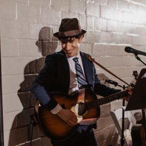 Andy McCarthy - Singing Guitarist / 1960s Era Entertainment in Houston, Texas