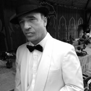 Ellis Martin as Humphrey Bogart - Impersonator in Los Angeles, California
